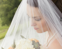 Crockette's Images Wedding Photography- bridal photo with a viel in front of face, and holding a bou